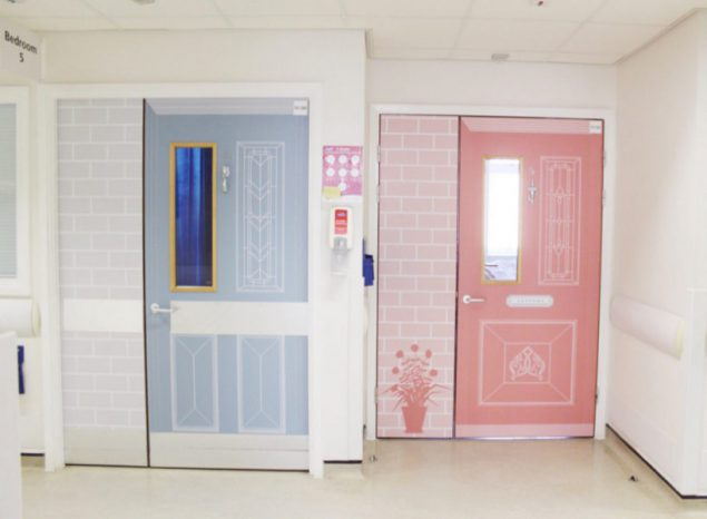 A pink and a blue door on Thistle Street in Newham hospital