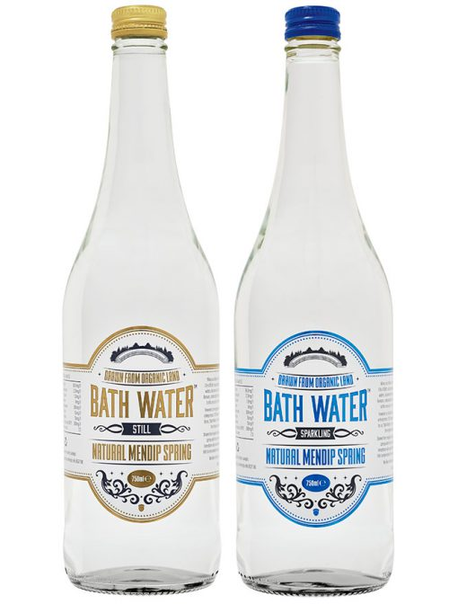 Two bottles of Bath Water, the Still water is on the left with yellow label and top, the sparkling is on the right with a blue label and top