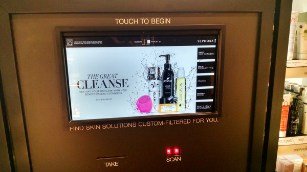 A touchscreen experience at a Sephora store, inviting customers to interact with the products