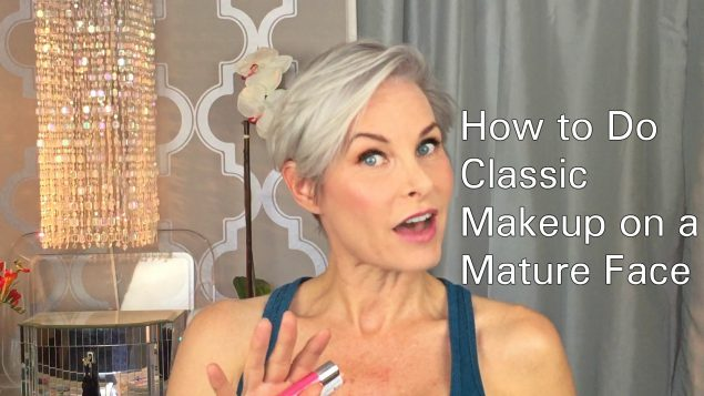 A short-haired lady looking into the camera, alongside the words how to do classic makeup on a mature face