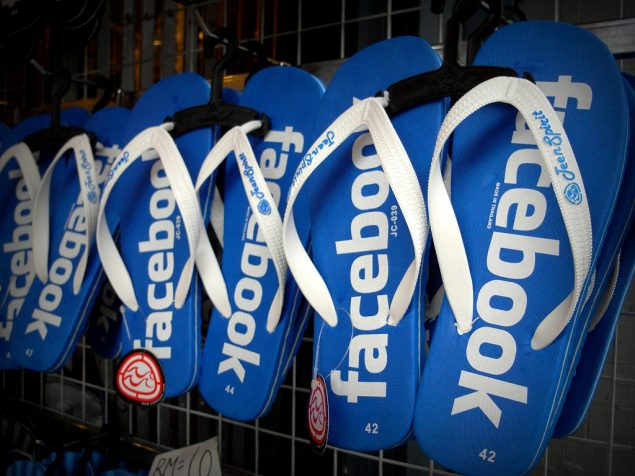 pairs of flip flops, or thongs for you American folks, with the facebook logo on them