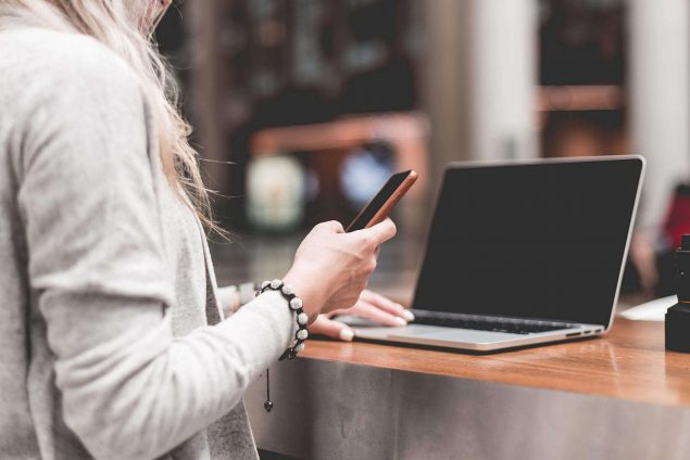 woman shopping on laptop and phone
