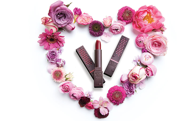 Lipsticks surrounded by flowers