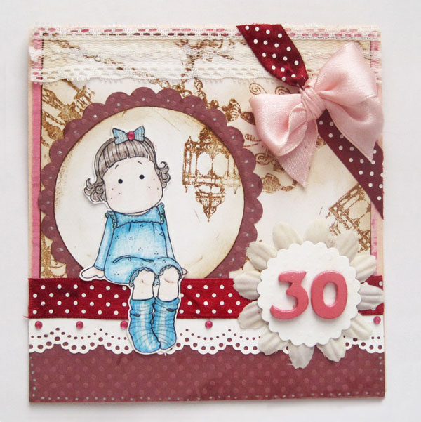 A thirtieth birthday card with a girl sitting on the front with a pink ribbon