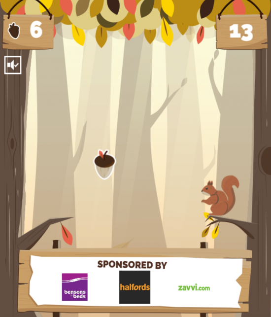 A still taken from Quidcos Nutz For Nuts digital game showing an animated squirrel on a branch, trying to catch a falling nut