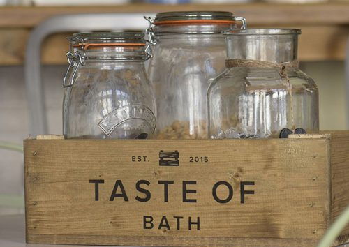 Three masn jars in a homemade apple crate with the Taste of Bath logo on it