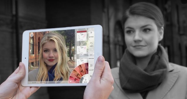 A lady using modiface's augmented reality beauty app to try on makeup virtually