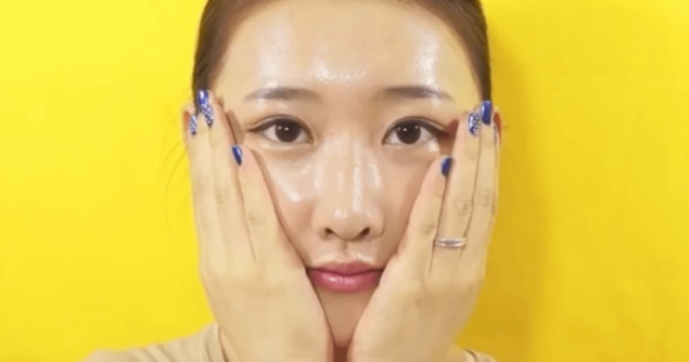 A Korean lady holding her face